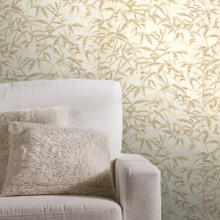 Gold and cream leaf pattern wallpaper on lounge wall