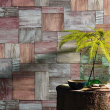 Faded red and blue wood blocks wallpaper on wall