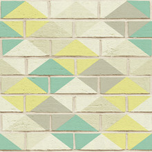 Green diamond harlequin on white brick wallpaper