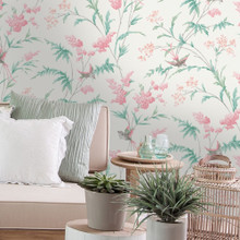 Coral flowers green leaves and birds on cream wallpaper