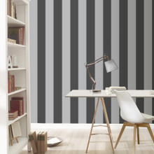 Silver and black striped wallpaper on a wall