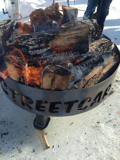 Custom heavy duty fire pit with legs and solid, welded steel bottom.