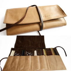 Made from luxurious cowhide leather, the Styling Roll Pouch by Fronis Hair is ideal for protecting all your valuable scissors, combs and other hair and make-up tools and accessories.  With nine pockets, this light weight beauty rolls up compact enough to comfortably fit in your satchel.  Available in black and a delicious camel colour.   Width 43cm  Height 24cm  Weight 210g