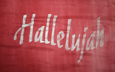 Hand dyed rose colored silk worship flag with Hallelujah in silvery white letters.