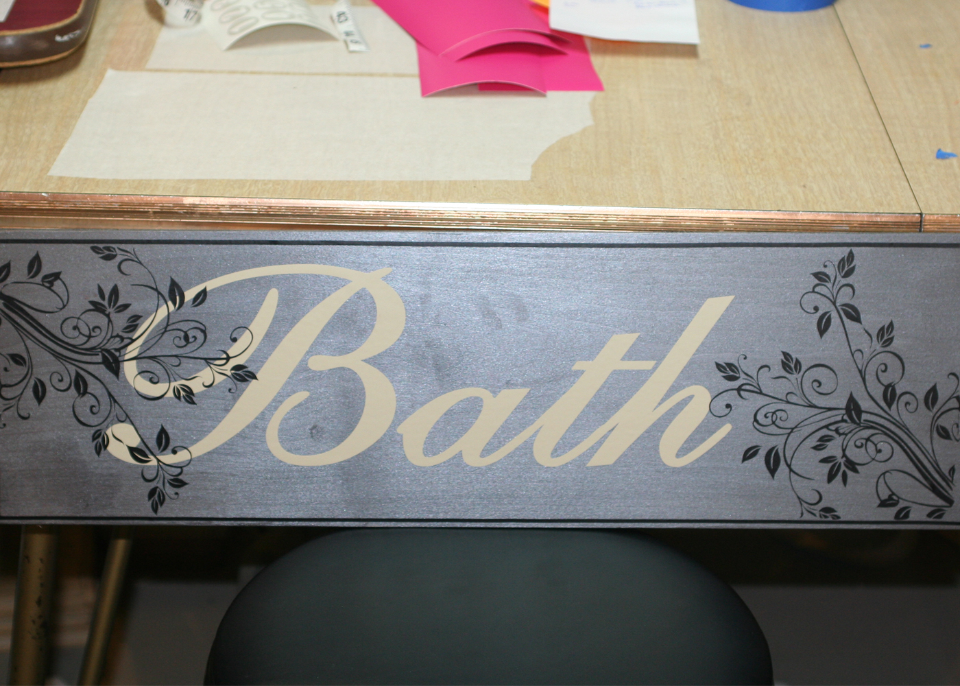 bath-vinyl-decal-lettering-with-scrolls-on-board.jpg