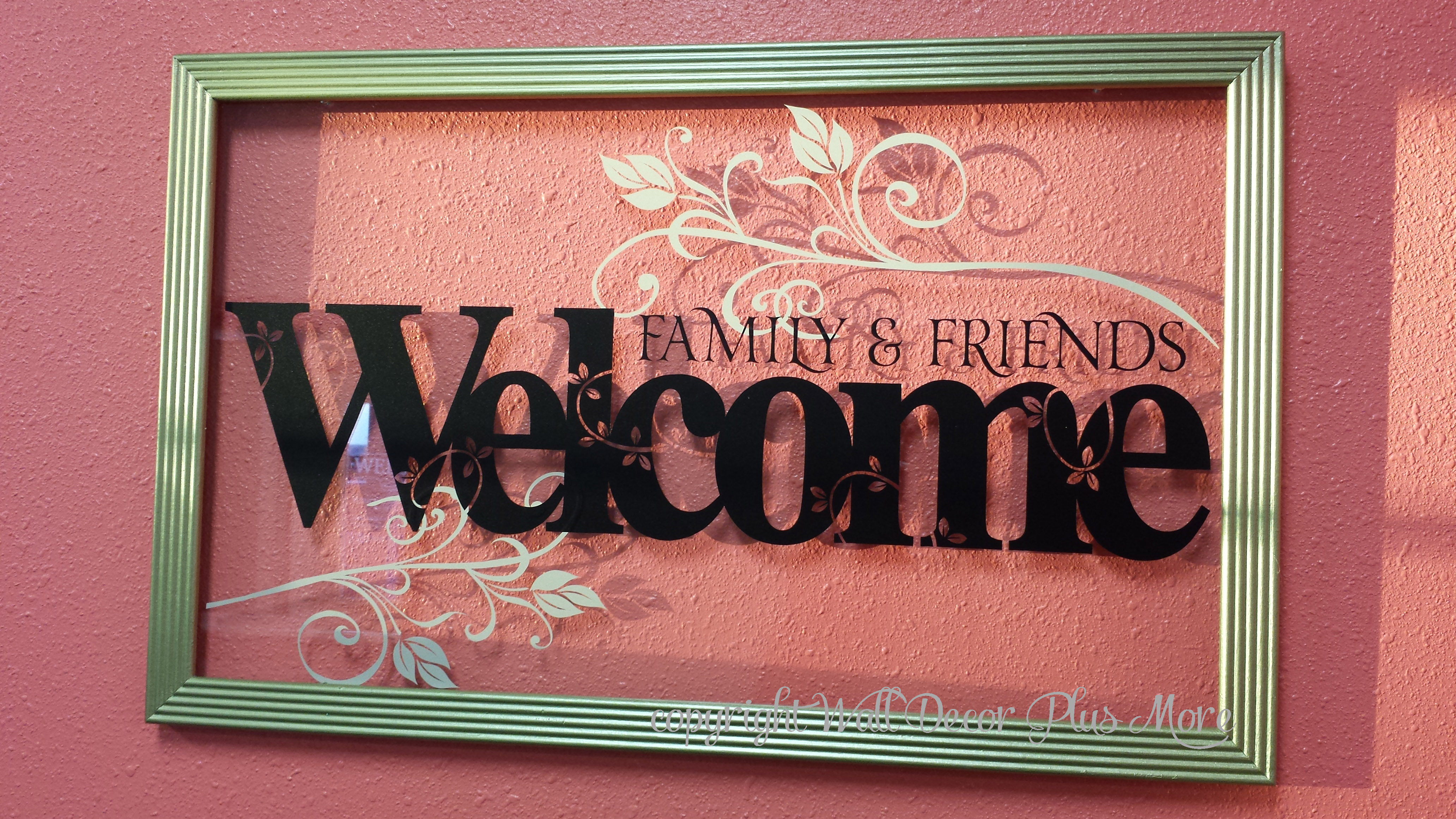 florals decorate the glass of floating frame along with welcome lettering