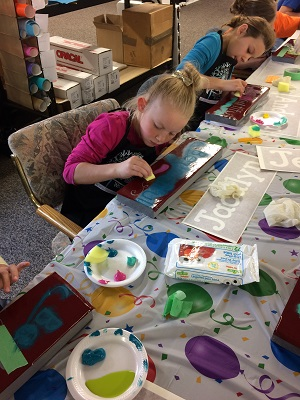 girls-painting-wood-birthday-party.jpg
