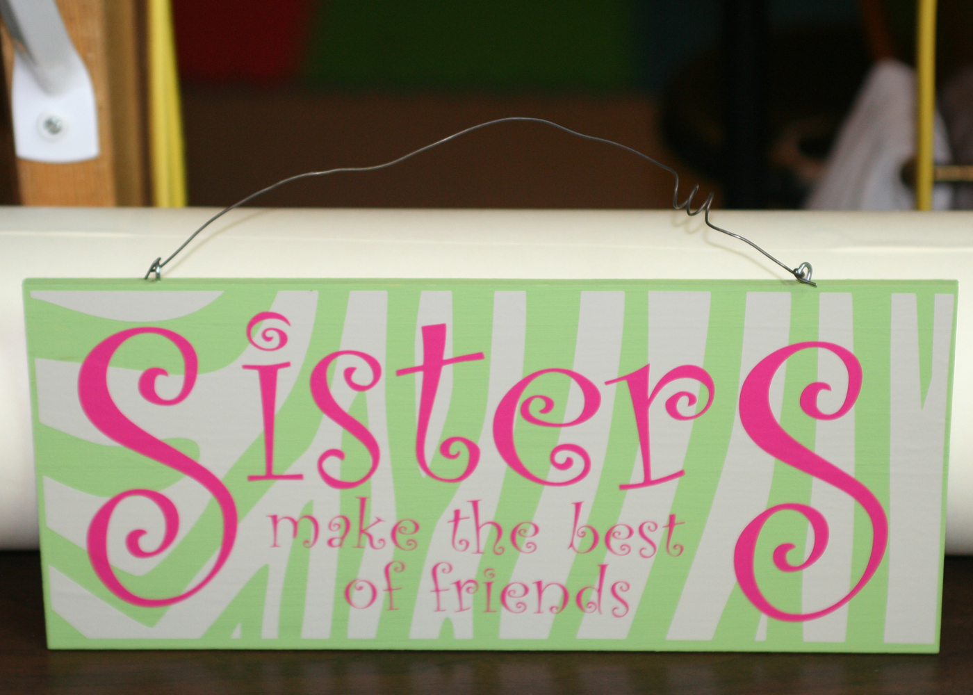 sisters-vinyl-decal-quote-on-board.jpg