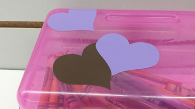 Purple and Chocolate Brown Heart Sticker on Child's Pencil Box