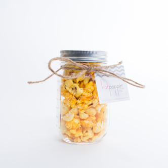 Our Hotpoppin Gourmet Popcorn placed into the class mason jar is the perfect gift for any baby shower, bridal shower or wedding favor!
