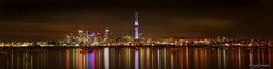 Auckland City at Night' Auckland, New Zealand cityscape showing skyline and reflections by Lucy G