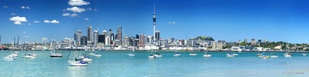 Auckland cityscape showing the city skyline over blue waters, photo art print for sale.