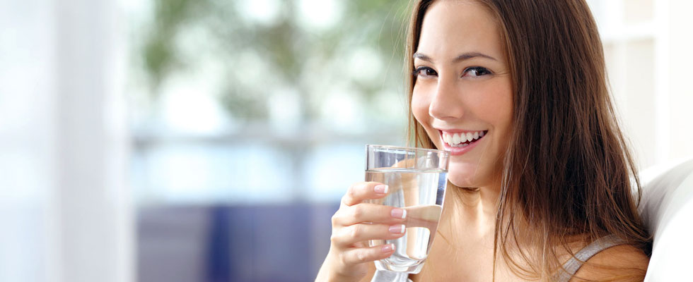 Woman drinking a glass of water