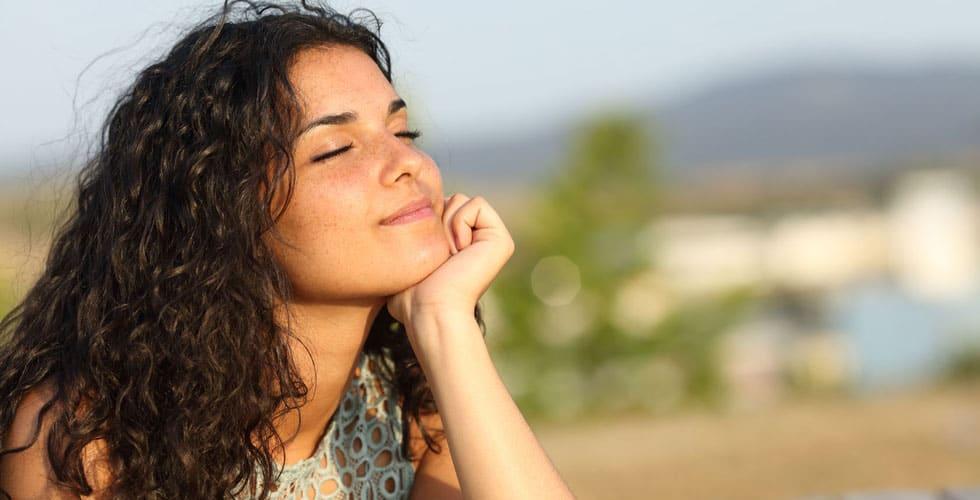Woman relaxing and enjoying the sun
