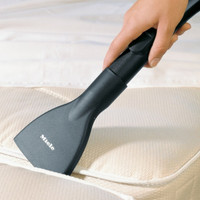 MIELE SMD10 MATTRESS TOOL, This wide, flat nozzle lets you reach between mattresses and bed frames to clean every last bit of dust and debris.