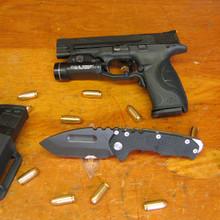 Medford Knife & Tool, Praetorian G, Black G10/Flame Finish, Titanium Oxide Blade front