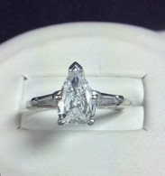 1.09 carat Pear Diamond Ring with Side Baguettes