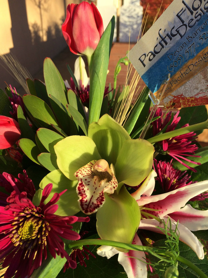 large orchid blooms with tulips, stargazer lily, iris and wheat