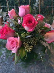 One Dozen Roses and greens with accents in a clear glass 5