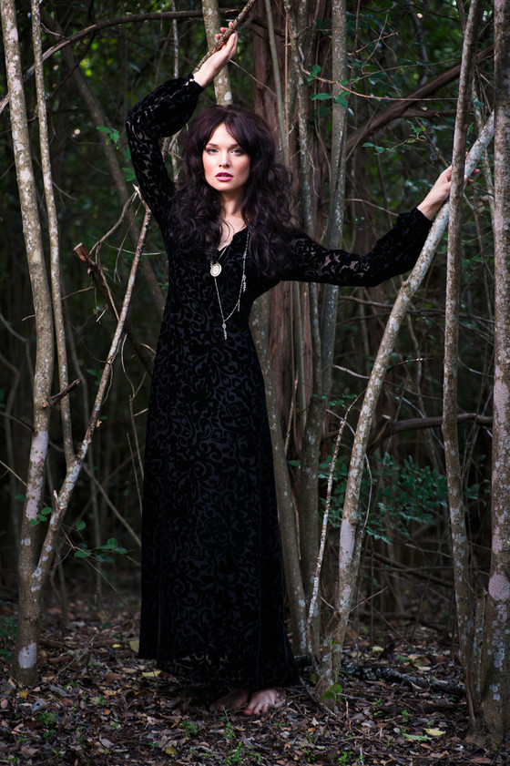 Black silk velvet maxi dress with a plunging neckline.  Made in the USA by evangeline clothing.