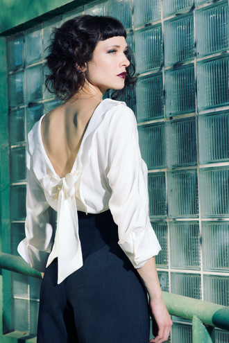 Ivory silk blouse with bow in the back and french cuffs.