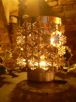 This Beautiful item spins as the heat of the candle builds up creating a lovely vision of moving Snowflakes.Made from Silver Stainless Steel but creates a lovely warm glow when lit in dim lighting