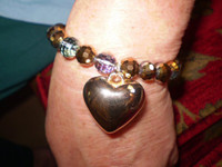 Danish gold coloured metal heart and Amber coloured facetted stones Stretch Bracelet
