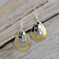 Small pair of gold plated earrings and a hammered silver accent piece.