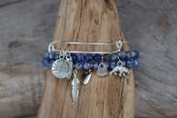 BLUE LAPIS STRETCH BRACELETS WITH A SILVER PLATED ADJUSTABLE BRACELETS, AND CHAMRS.....
