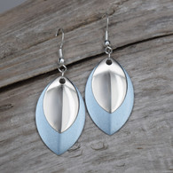 SEA BLUE EARRINGS WITH A SILVER ACCENT PIECE. STERLING SILVER EAR WIRES.