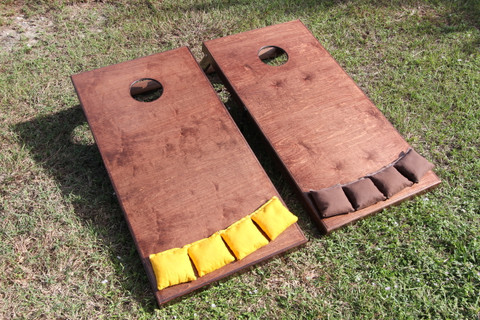 Slimline Cornhole Boards stained in mahogany and clear finished