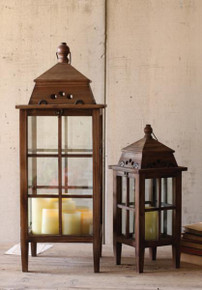 SET OF TWO TALL WOOD AND GLASS LANTERNS