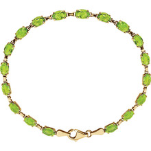 Brilliant oval genuine peridot gemstones set in 14k yellow gold in this eye-catching bracelet.