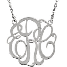 Give her a classic necklace that is personal and individual for her. Fashioned in sterling silver, a circle frames three initials of your choice, in an elegant flowing script monogram font. Enter the initials in the order you would like them. Polished to a bright shine, the pendant suspends on a rope chain that secures with a spring-ring clasp.