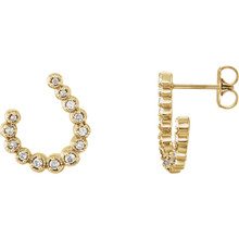 These 1/4 ct. t.w. diamond crescent drop earrings are set in 14K yellow gold and secure with friction backs.