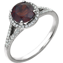 Beautiful Halo-style Gemstone Ring in 14K White Gold featuring a Natural Garnet Gemstone & Diamonds. The ring consist of 1 Round Shape, 7.0 mm, Garnet Gemstone with 56 Accent genuine Diamonds. This ring is both Elegant and Classic - Perfect for everyday. The inherent beauty of these gems make this an ideal way for you to show your love to someone you care for.