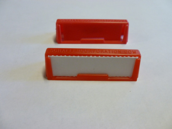 Label holder clips to a box or clips two boxes together
