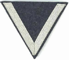 WW2 German Luftwaffe Gefreiter (Lance Corporals) sleeve chevron, one 9mm silver chevron sewn on a inverted LW blue wool triangle. There are slight variations of material backing, colour and embroidery style between these patches.