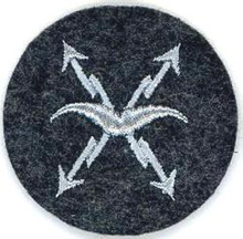 "WW2 German Luftwaffe Air-Raid Warning Personnel Sleeve Insignia. Grey ""gull"" and sparks on a blue-gray wool disc. There are slight variations of material backing, colour and embroidery style between these patches. Exc."