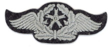 WW2 German Luftwaffe flight technical staff sleeve insignia Sleeve Insignia. Grey winged motor on a blue-gray wool disc. There are slight variations of material backing, colour and embroidery style between these patches.