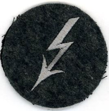 "WW2 German Luftwaffe Radio Telephone Operators sleeve insignia. Grey Lightening bolt ""Blitz"" on a blue-gray wool disc. There are slight variations of material backing, colour and embroidery style between these patches."