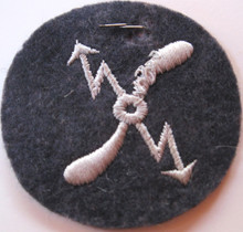 WW2 German Luftwaffe Electro-Mechanical Specialist Patch with Tag. Shows a few tiny moth bites and broken threads.