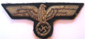 World War II German Kriegsmarine Officers hand embroiderd breast eagle in gold bullion wire, with age-related patina. Two-tone embroidery of at least five different gauges of wire on KM midnight blue wool.