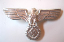 WW2 German NSFK Kepi Eagle in Aluminum, With Prongs. Shows light oxidation and shelf wear but appears unissued.