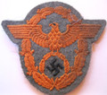 """WW2 German Army Feldgendarmerie (Military Police) Sleeve Eagle from """"The Dachau Hord"""". The color varies between late war police green and Felgrau 44 due to then available materials and dye lots."""