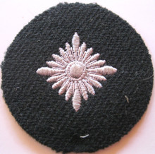 WW2 German Army Panzer or WSS 'Oberschutze' Sleeve Rank Patch, machine embroidered four pointed 'pip' on a BLACK private purchase heavy wool disc with backing. Rare.