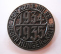Prior to 1933 due to the depression hunger was widespread in Germany as tens of millions of German workers were left unemployed and destitute. After attaining power in 1933 the NS Regime launched massive efforts to combat unemployment and hunger, launching many initiatives to address these pressing problems. Die struck, hollow with 99% finish and pin back.