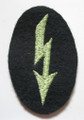 "WW2 German Army Panzer-grenadier or Kradschützen Signals Sleeve Patch. An apple green machine embroidered ""blitz"" on a dark blue-green wool oval. One of the scarcer colours."