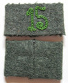 "WW2 German Army Grenadier Regiment 15 EM / NCO Shoulder Strap Slides, Pair. Field-grey wool construction slip on shoulder strap slides with a machine stitched seam to the reverse and Grass green chain stitched numerals ""15"" to the obverse. Formed in March, 1943 from remnants of Infantry Regiment 15 which was destroyed at Stalingrad the unit became part of the new 29th Infantry Division and deployed to Southern Italy where they saw very heavy combat. The Regiment fought in Monte Casino, Anzio, and the Adriatic theater ending the war in near Monte Belvedere in the Italian Alps.  Slip on shoulder strap slides for wear by enlisted personnel were introduced in January, 1940 for economic and security reasons. The slides were cheaper and easier to produce then full shoulder straps and could be easily changed if an individual was transferred or removed in the field to conceal unit designations. The shoulder strap slides generally had a unit numeral or specific designation letter chain stitched in the appropriated waffenfarbe (Branch of Service Color). In 1943 all embroidery was changed to gray, reflecting the shortage of dyes, materials and difficulty of keeping up with the constant reorganization of units as the war progressed.  Pair. Exc."