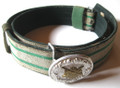 WW2 German Schützenvereine (Rifle Club)  Officers Feldbinde und Feldbindenschloß für Offizier (brocade belt and aluminum buckle). The belt is fabricated with a fine aluminum wire interlaced with white threading on the upper, incorporating two rows of forest green embroidery, the edges and reverse in green wool, two sliders with matching uppers and reverses to that of the belt, the right end finishing in a point with a hook that faces a single row of nine holes for length adjustment, die-stamped silvered aluminum buckle affixed to the right end, the buckle illustrating a Schützenvereine emblen, center. The tag is hard to read and appears to have a stock number and sellers name on it. Someone later wrote a price in DM on it using a ball point pen. This item was acquired by one of our staff at a flea market near Munich in the 70's. Shows wear from use, and a nice patina. VG.